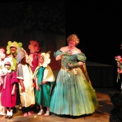 The Good Witch and the Munchkins greet Dorothy and Toto