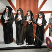 "The Abbess and her ""nunettes"" watch the contest"